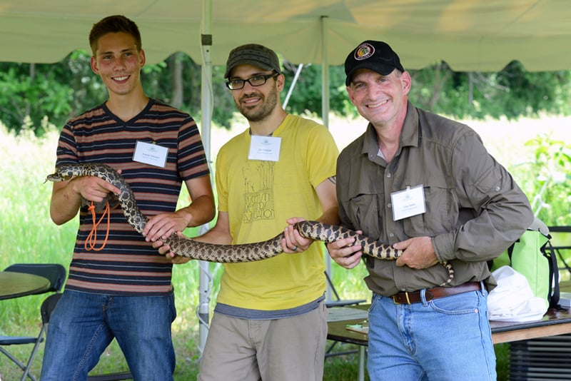 A six-foot-long bull snake was the star of the show at the BioBlitz on June 13, found by herpetologist Tom Anton (right) and his assistants Tristan Schramer and Joe Cavataio. Photo by Gary Sullivan/TWI.