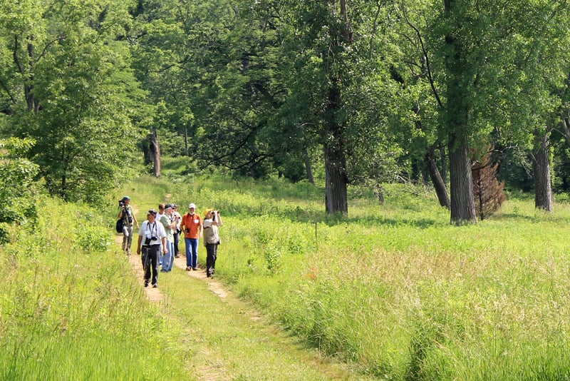 A survey group returns from a hike down the Dixon Refuge's wooded seep trail to the Dore Seep Nature Preserve. Photo by Beth Botts.