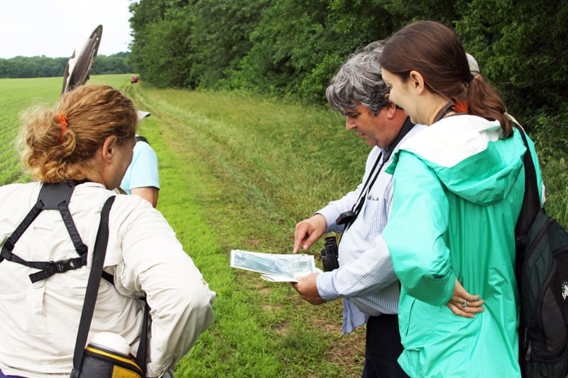 Field Museum ornithologist Doug Stotz consults a map with citizen scientists before beginning his survey of Hickory Hollow, the new tract recently added to the Dixon Refuge. Photo by David Miller.