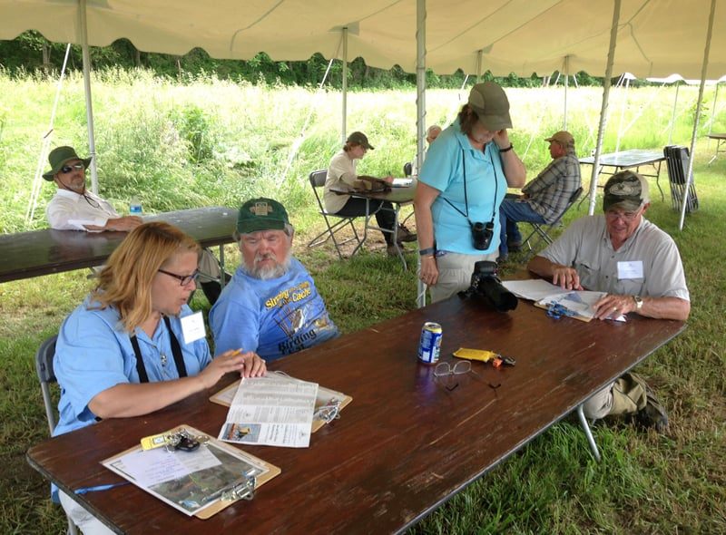 Experts cool off, review their checklists, and tally species at the end of the BioBlitz on Sunday. Photo by Vera Leopold.