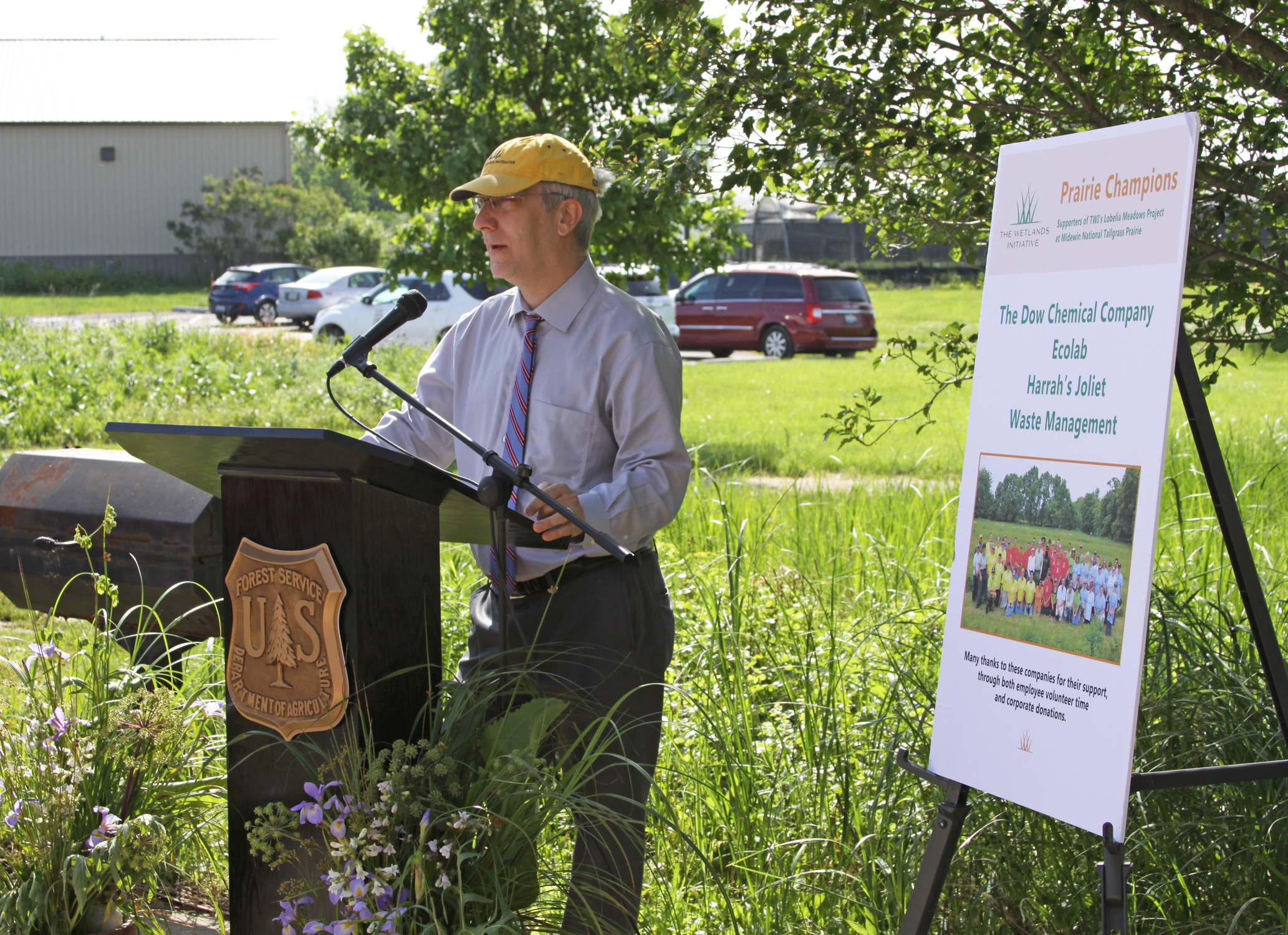 Paul Botts, TWI's Executive Director, speaks during the Prairie Champions event. This special event recognized four local companies that have supported TWI's Lobelia Meadows project at Midewin through both employee volunteering and corporate donations.