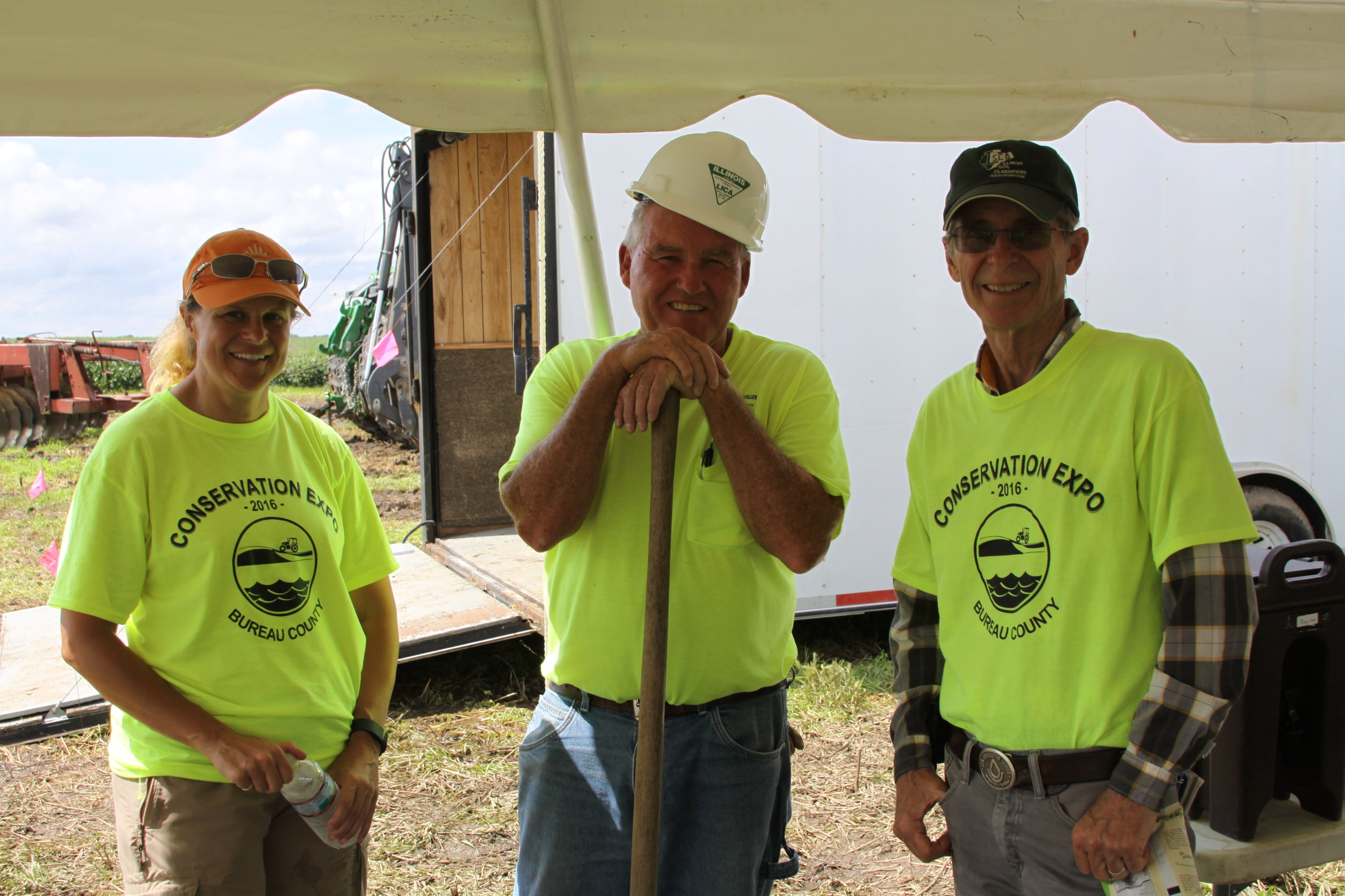 From left to right: TWI Senior Environmental Engineer Dr. Jill Kostel, ILICA contractor Wes Litwiller, and soil scientist Steve Zwicker during wetland construction on Bonucci Farms.