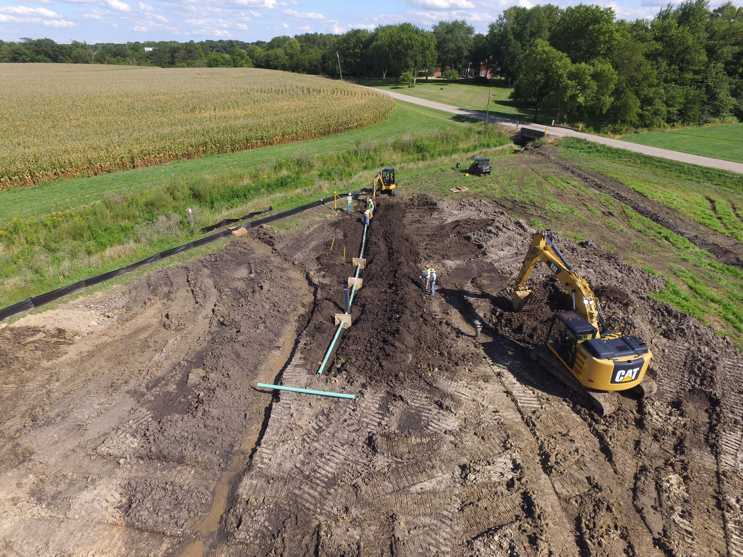 ILICA contractors at Bonucci Farms install the outlet pipe and water-control structure that will maintain water levels in the constructed wetland.