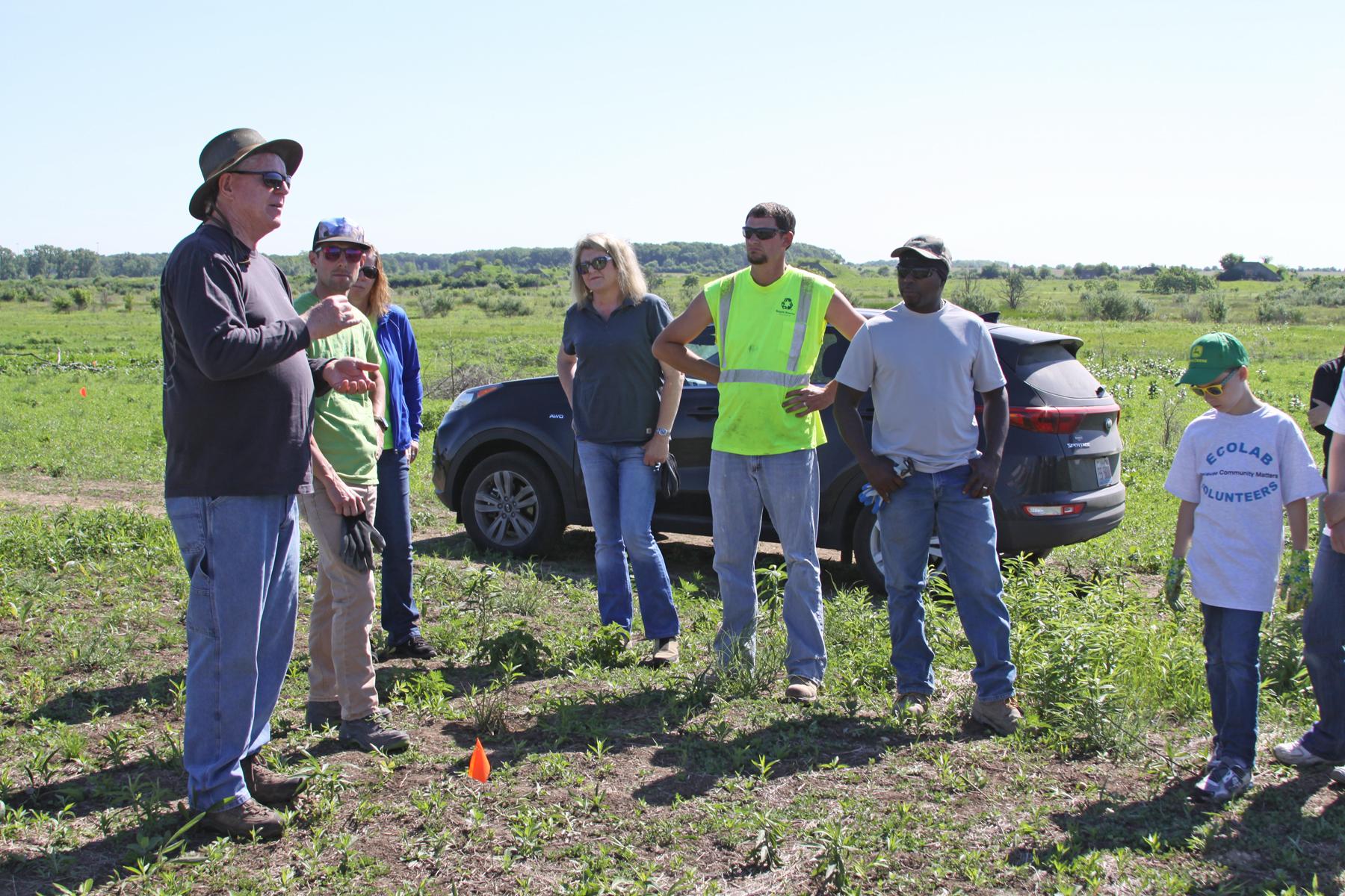 TWI's Senior Ecologist Dr. Gary Sullivan orients volunteers to Midewin National Tallgrass Prairie and the restoration effort.