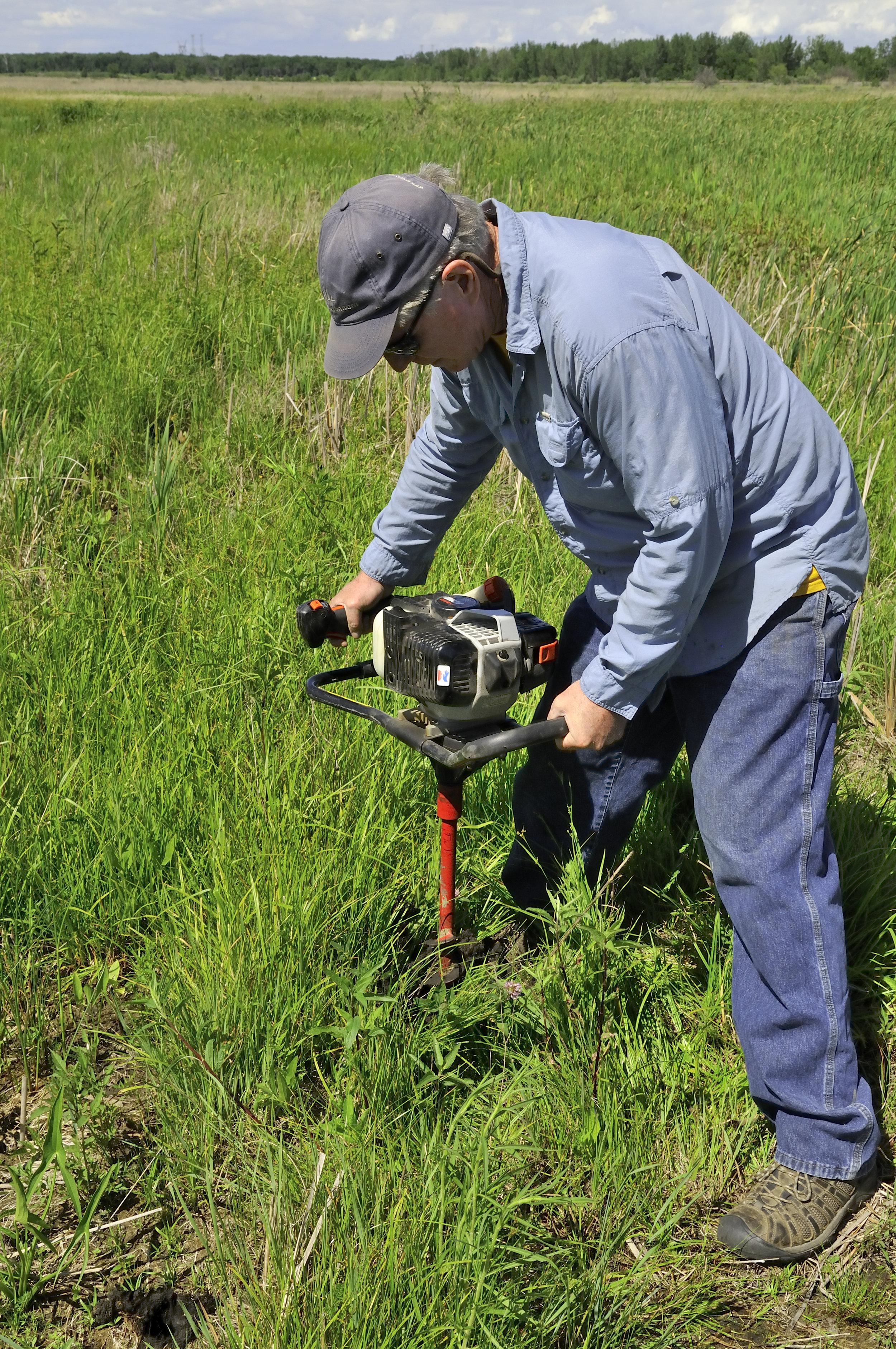 TWI Senior Ecologist Dr. Gary Sullivan drills a monitoring well at Lobelia Meadows at the start of restoration. Photo by Iza Redlinski/TWI.