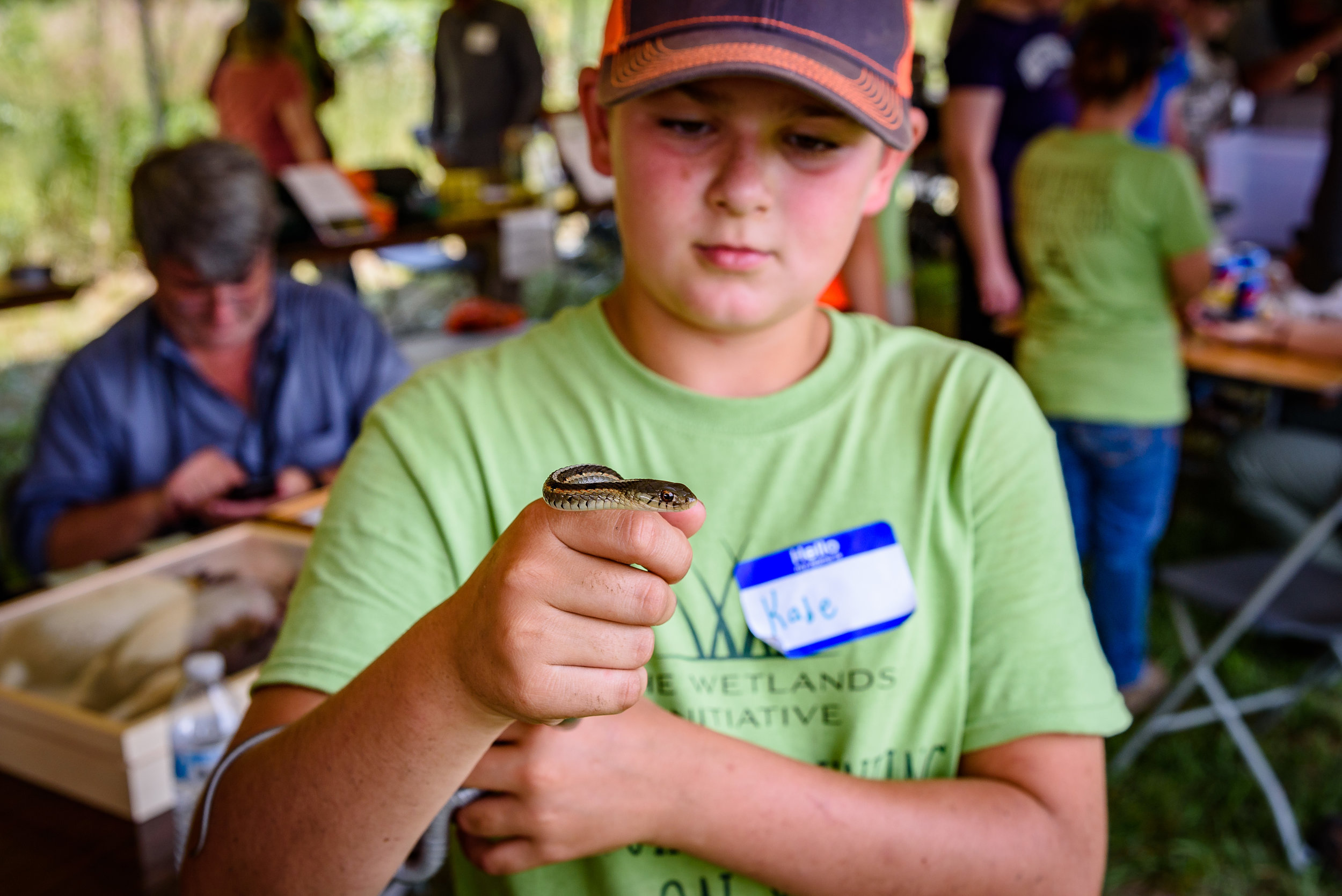 A young BioBlitz participant gets friendly with a garter snake. Photo by Rafi Wilkinson.