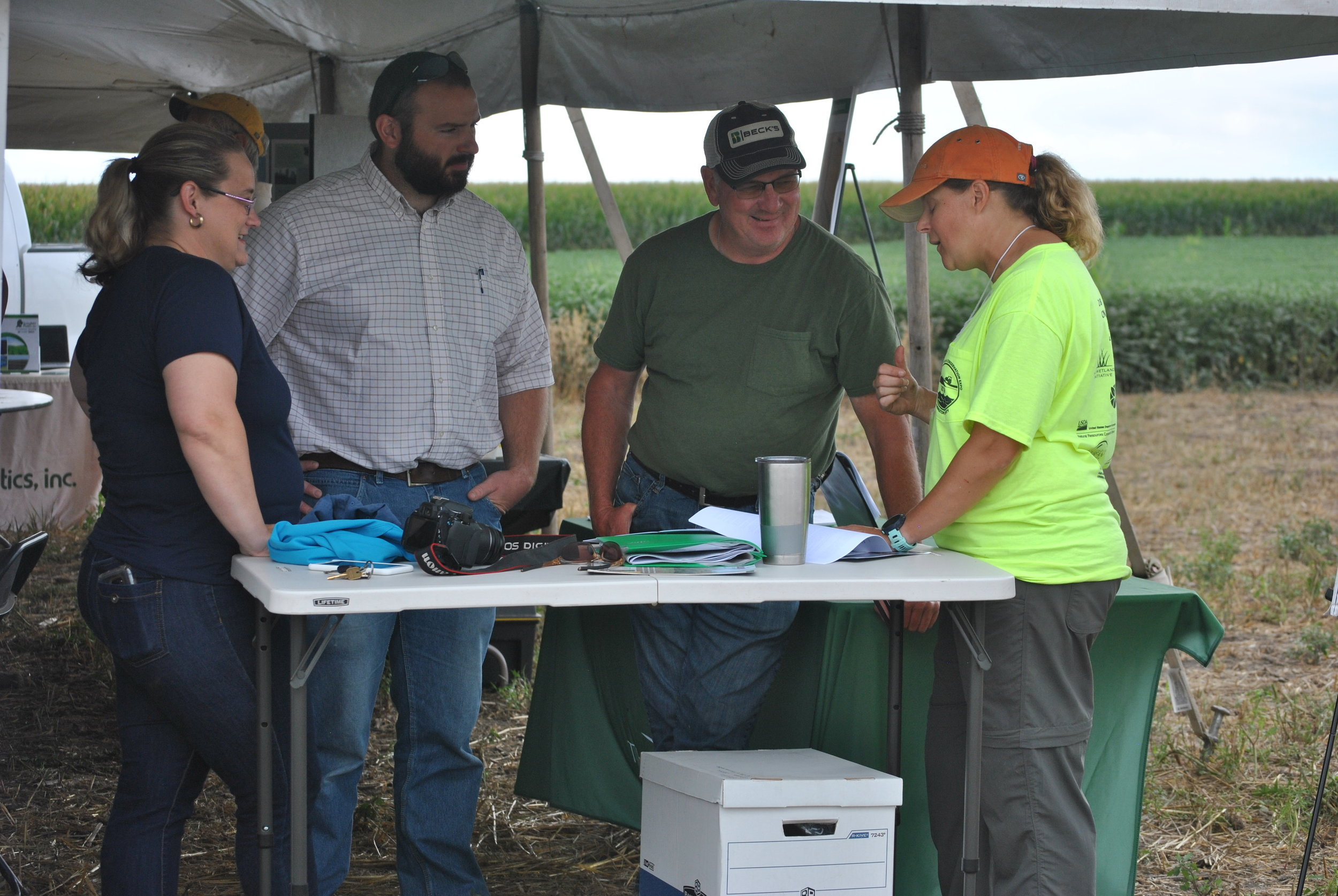 TWI Senior Environmental Engineer Dr. Jill Kostel (in orange cap) speaks with LCSWCD Resource Conservationist Becky Taylor, NRCS District Conservationist Adam Wyant, and a local farmer (from left to right). Photo by Jean McGuire/TWI.