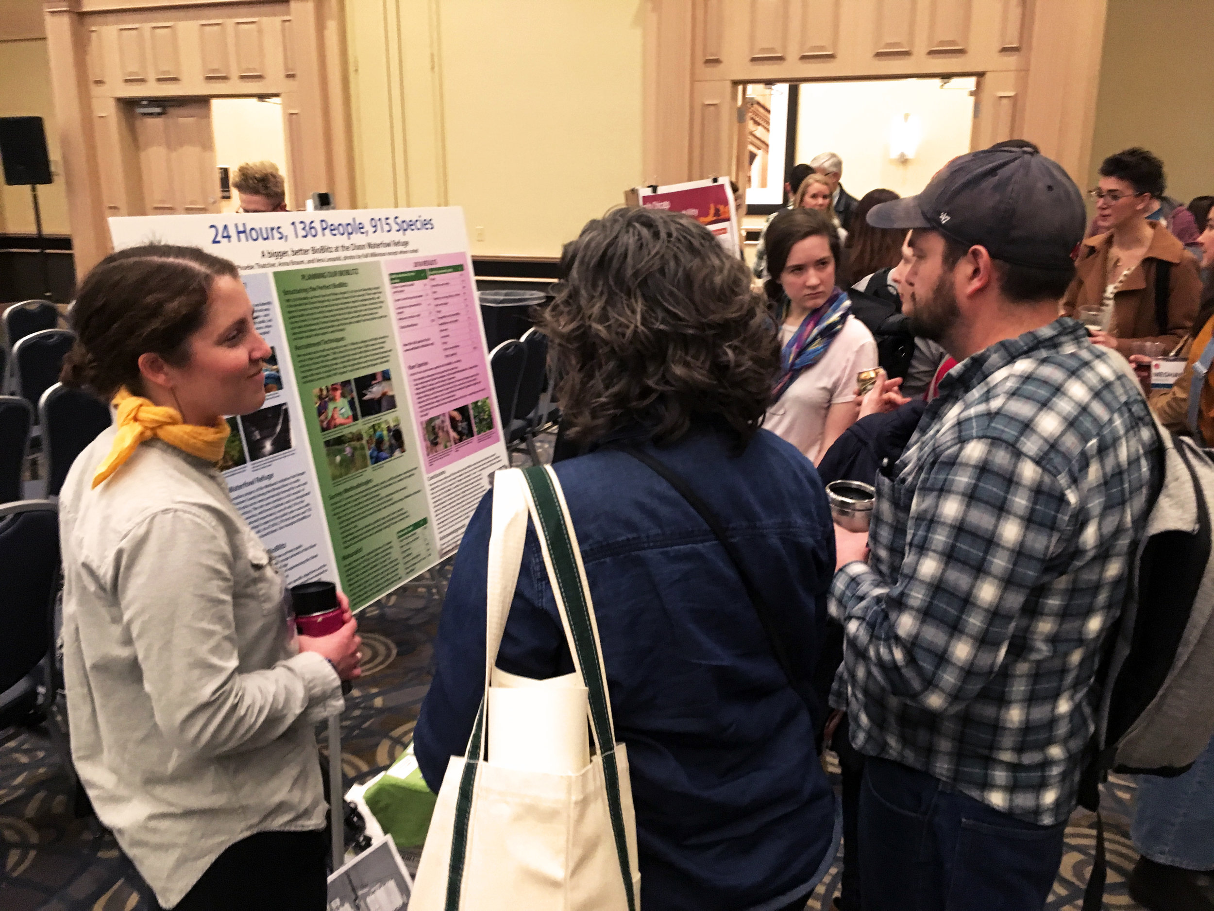 TWI Ecologist Anna Braum (left) and Development and Communications Assistant Phoebe Thatcher (in pink t-shirt) discussing the 2018 BioBlitz experience with Wild Things attendees. Photo by Vera Leopold/TWI.