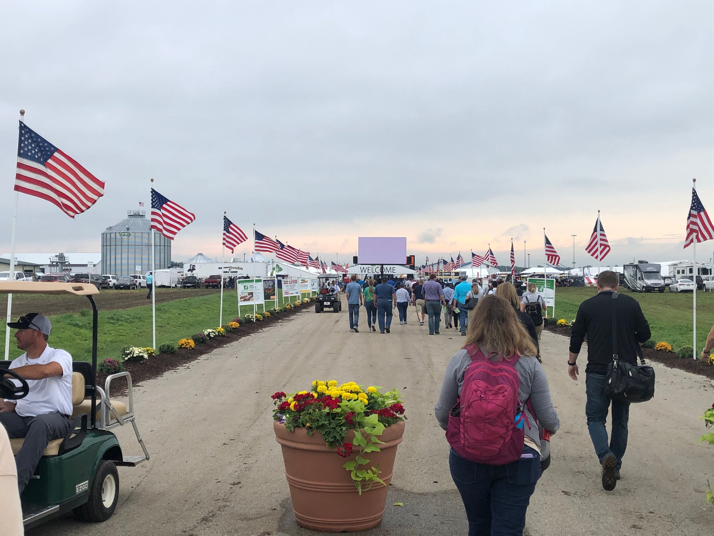 Jill Kostel, TWI's senior environmental engineer, approaches the main entrance gate to the huge Farm Progress Show in Decatur, Illinois. Photo by John Briel/TWI.