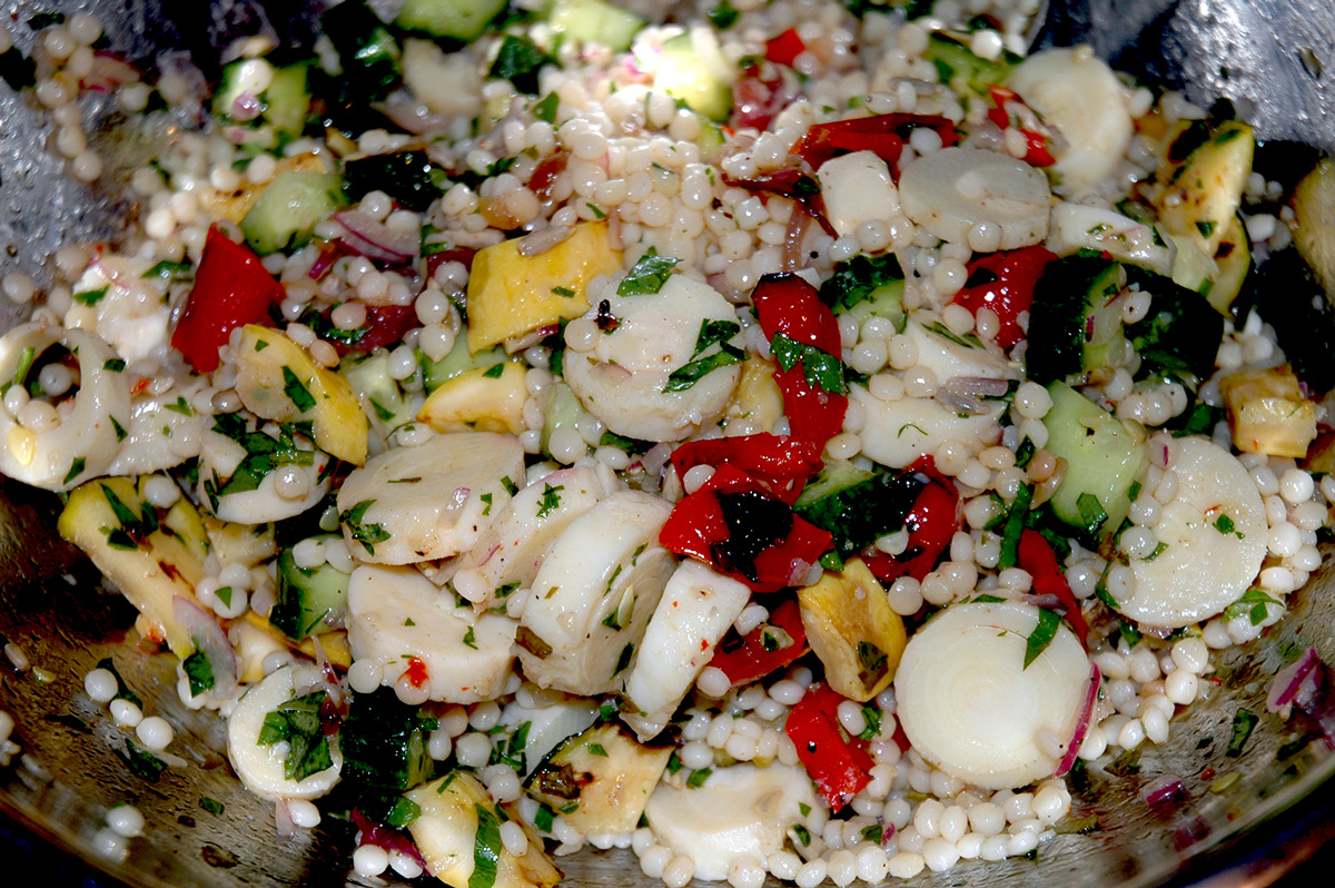 Israeli Couscous with grilled zucchini, summer squash, roasted red pepper, hearts of palm and a basil dressing.