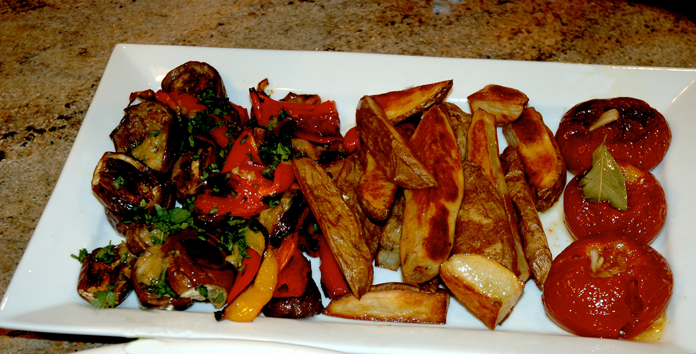Grilled veggies, roasted potatoes and grilled tomatoes