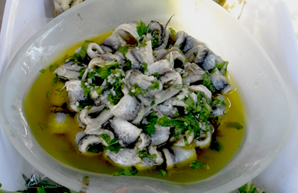 Garnished with crushed garlic, chopped parsley and fruity olive oil