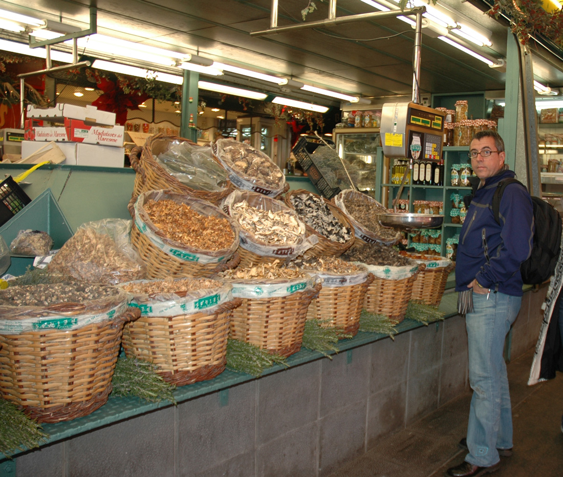 JuanCarlos in his glory in front of a large variety of dried mushrooms in Barcelona.