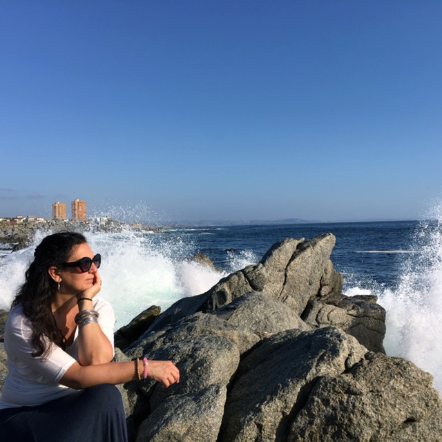 Thinking of all my fortunes perched on a rock overlooking the Pacific in Chile.