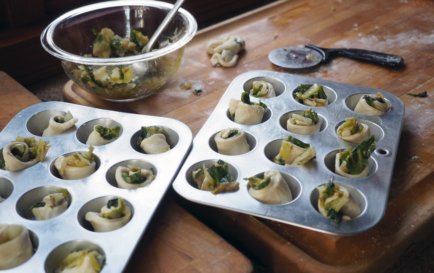 Place your rolled up delights into lightly oiled mini cupcake tins.