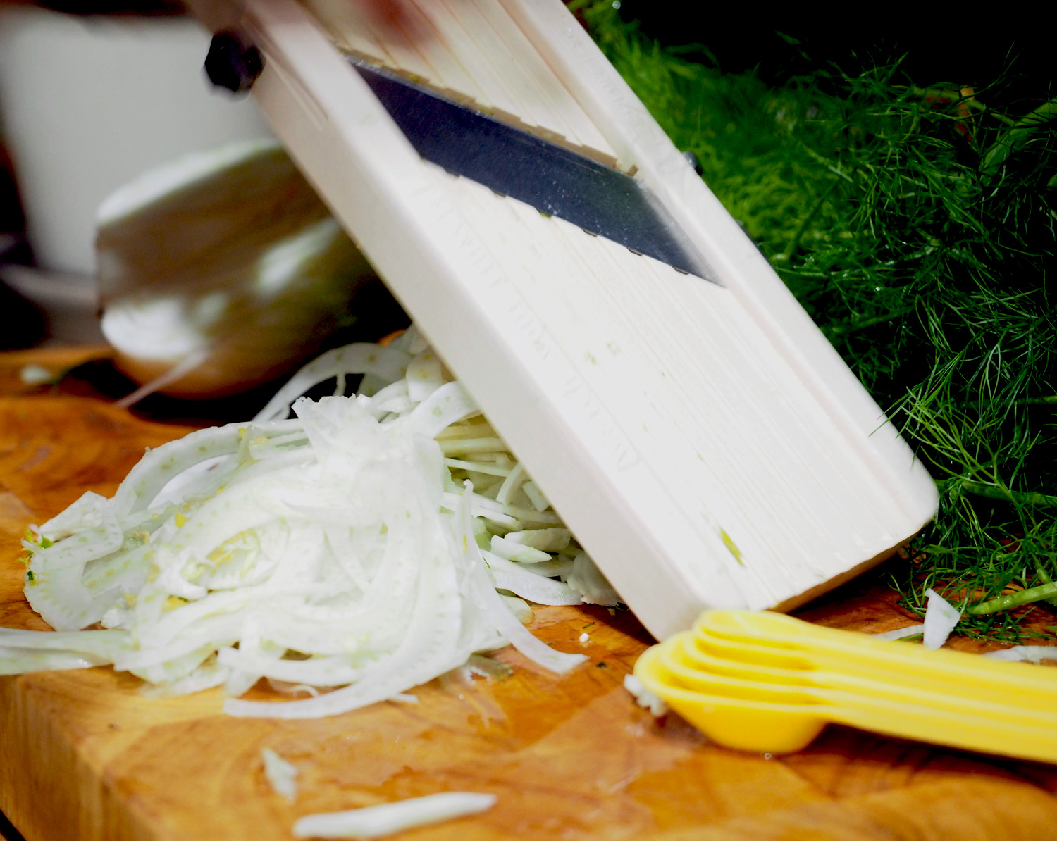 Thin slivers of fennel.  I love using a mandolin, but please watch your fingers!