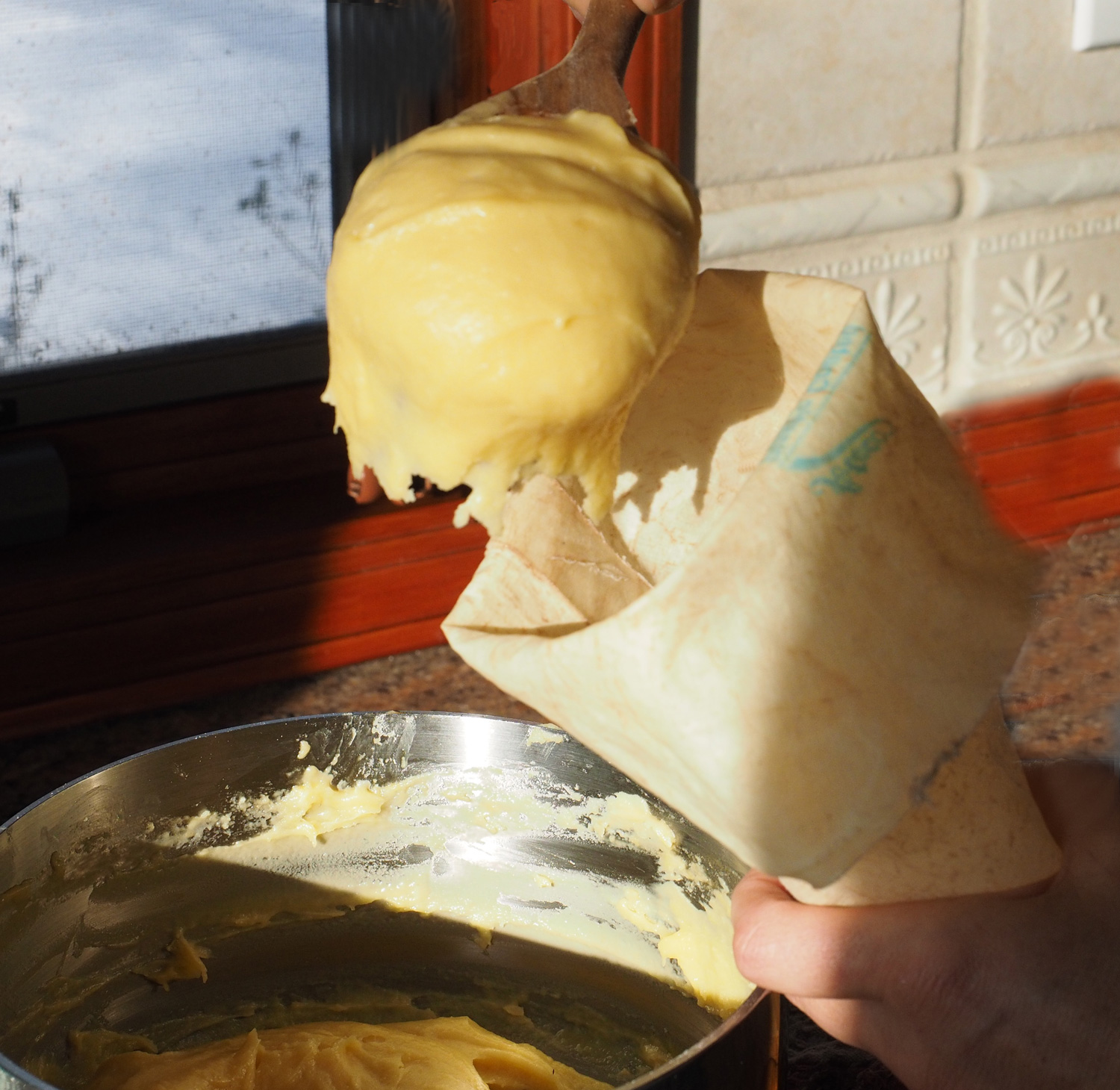Spoon into piping bag. You can also use a large plastic bag and cut the corner off.