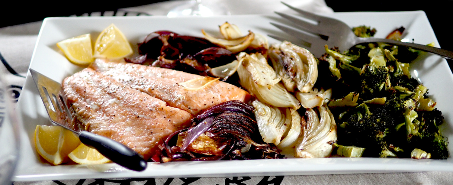 Simply roasted salmon nestled up against beautiful roasted vegetables all on one plate.