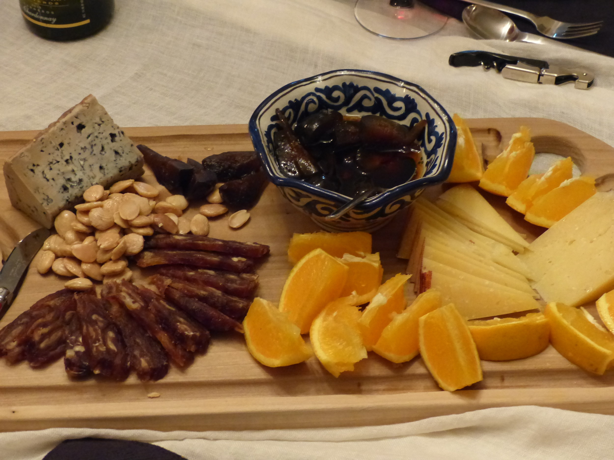 Blue cheese (such as  Cabrales ,  Valdeon,  Stilton or Gorgonzola). Add nuts, date loaf, figs in syrup, oranges.