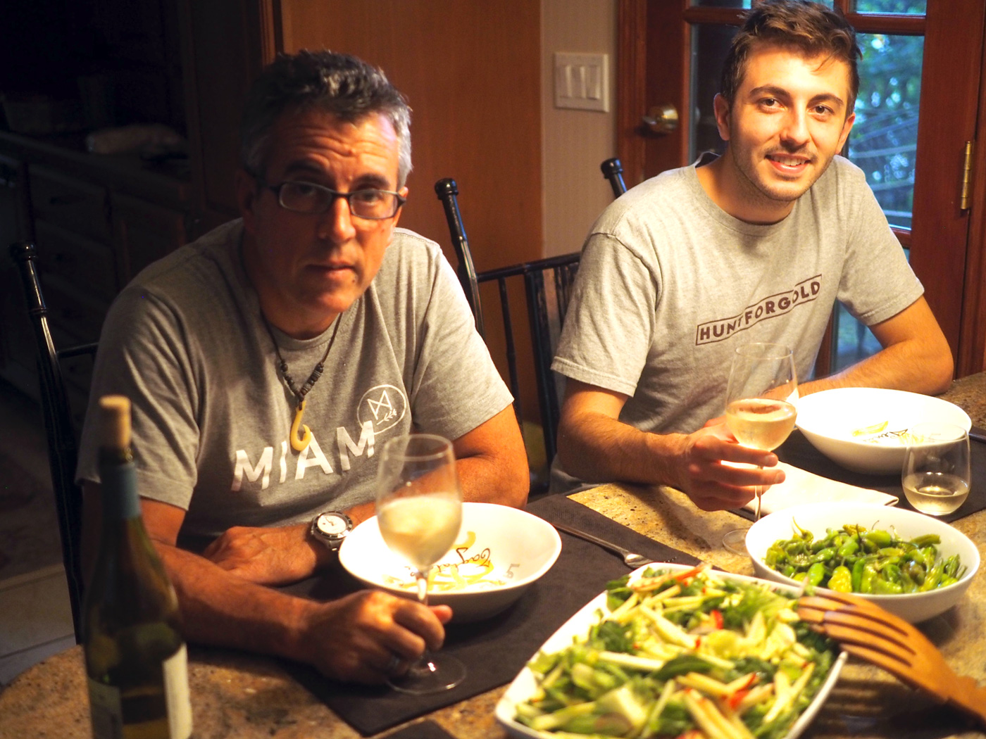 Two handsome, hungry, thought provoking men waiting for the picture to be taken so the eating can begin.