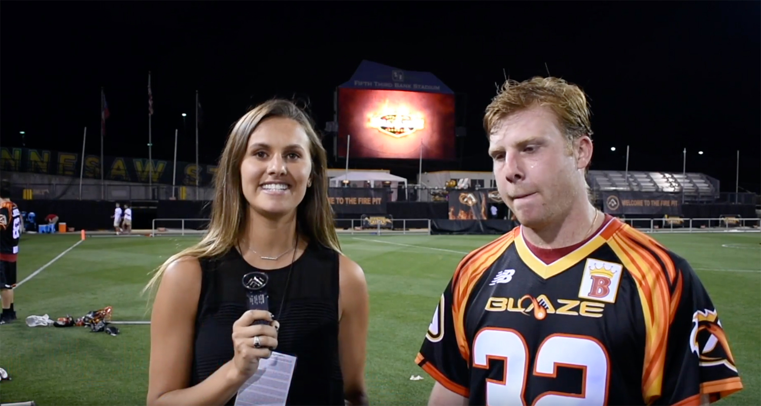 Michella interviewing the lacrosse MVP.