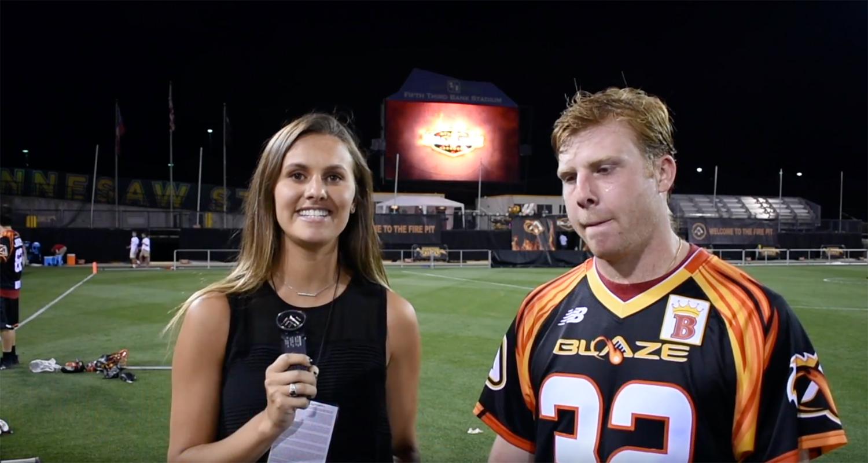 Michella interviewing the lacrosse MVP.