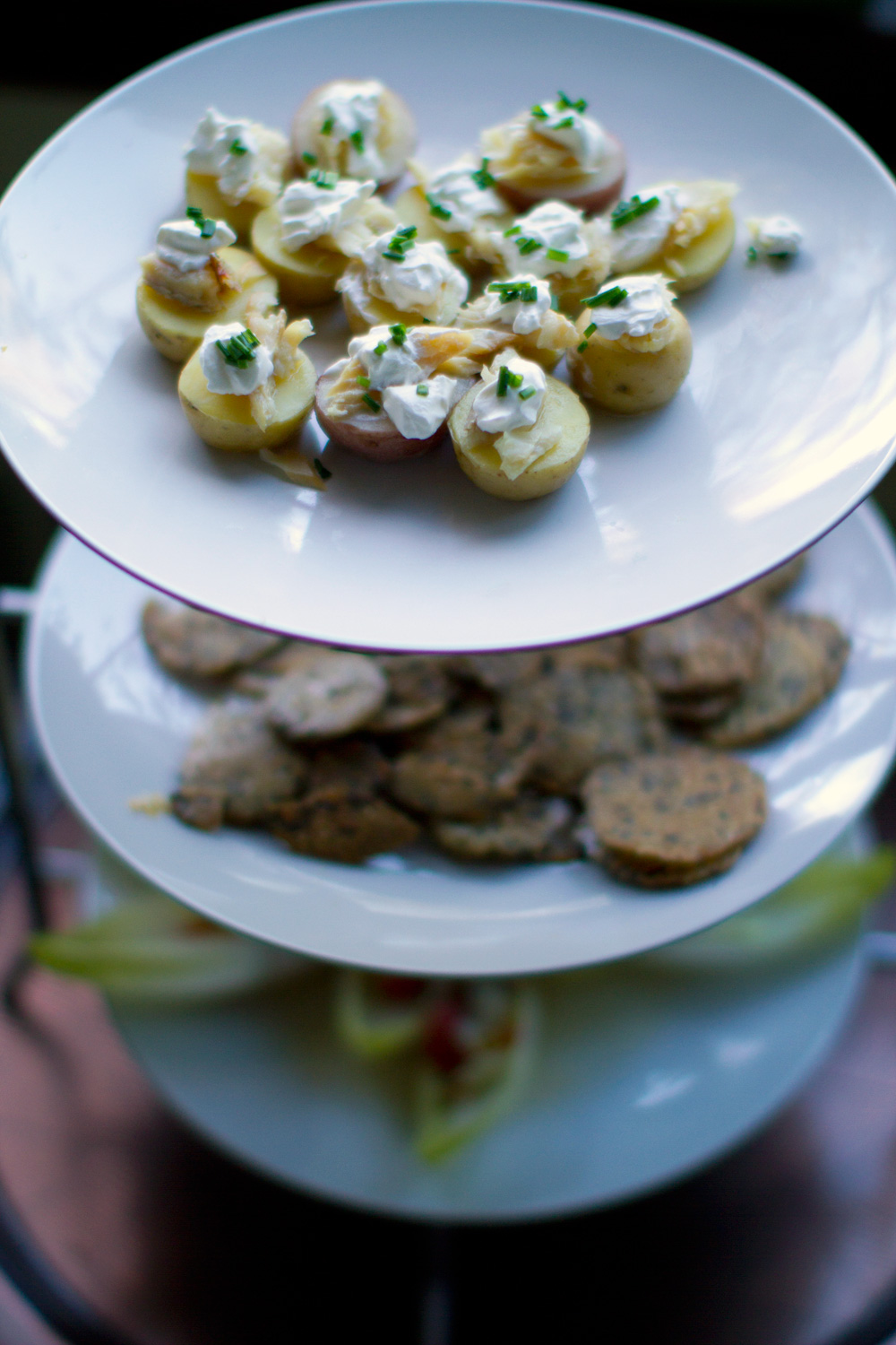 Little bites of yum, smoked trout with sour cream & chives on potato rounds