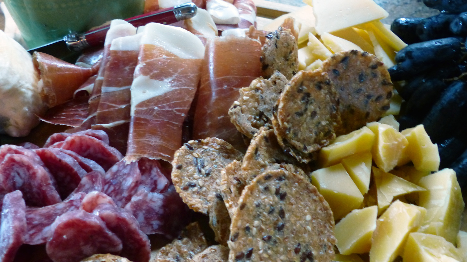 Charcuterie & Cheese Platter, chock full of  Serrano ham, chorizo, Mahon Curado  cheese, grapes,  Marie's Gone Crackers