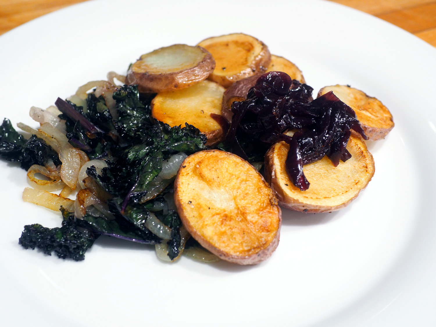 Sautéd purple kale, onions with pan seared potatoes topped with onion jam.