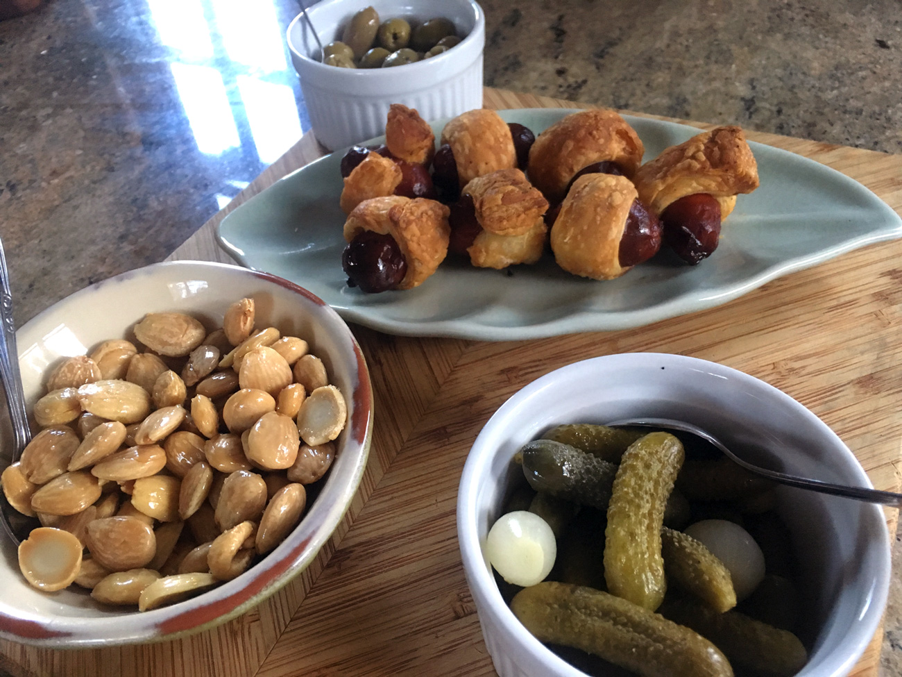 The puff pastry adds a buttery flavor that complements the spice of the chorizo. These are a more grown up way of serving Pigs in a Blanket. Adding a nod to France, I mixed up whole grain mustard with dijon for dipping. Marcona almonds and cornichons for crunchy, salty bites.