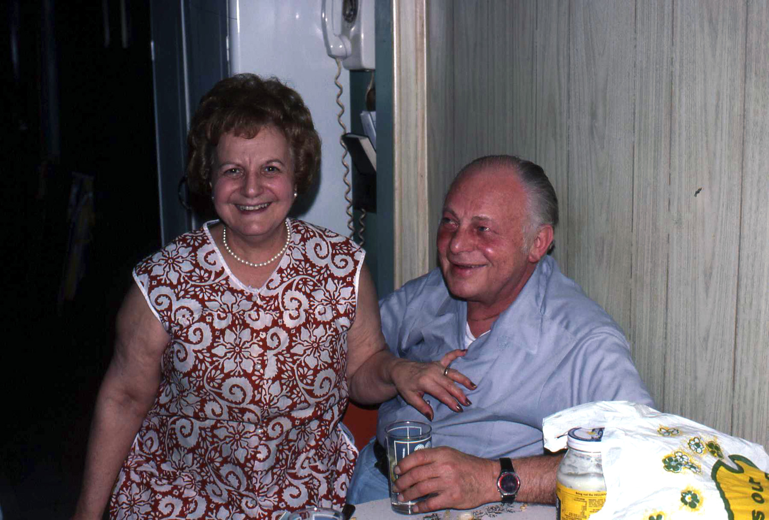 After decades of marriage, she was still sitting on his lap, full of smiles as they shared food, laughter and love with family. Those smiles tell the story.  Photo credit: Paul Majewski