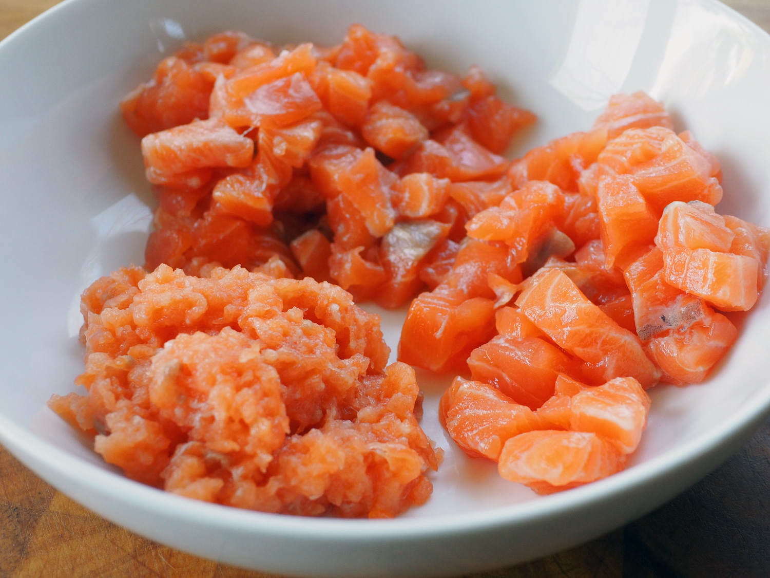 Salmon prepped in 3 sizes: Big cubes, smaller cubes and a paste.