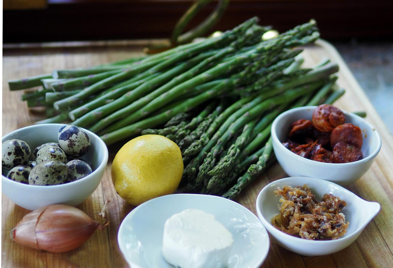 Asparagus, chorizo, caramelized onions, goat cheese, lemon, shallot, quail eggs.