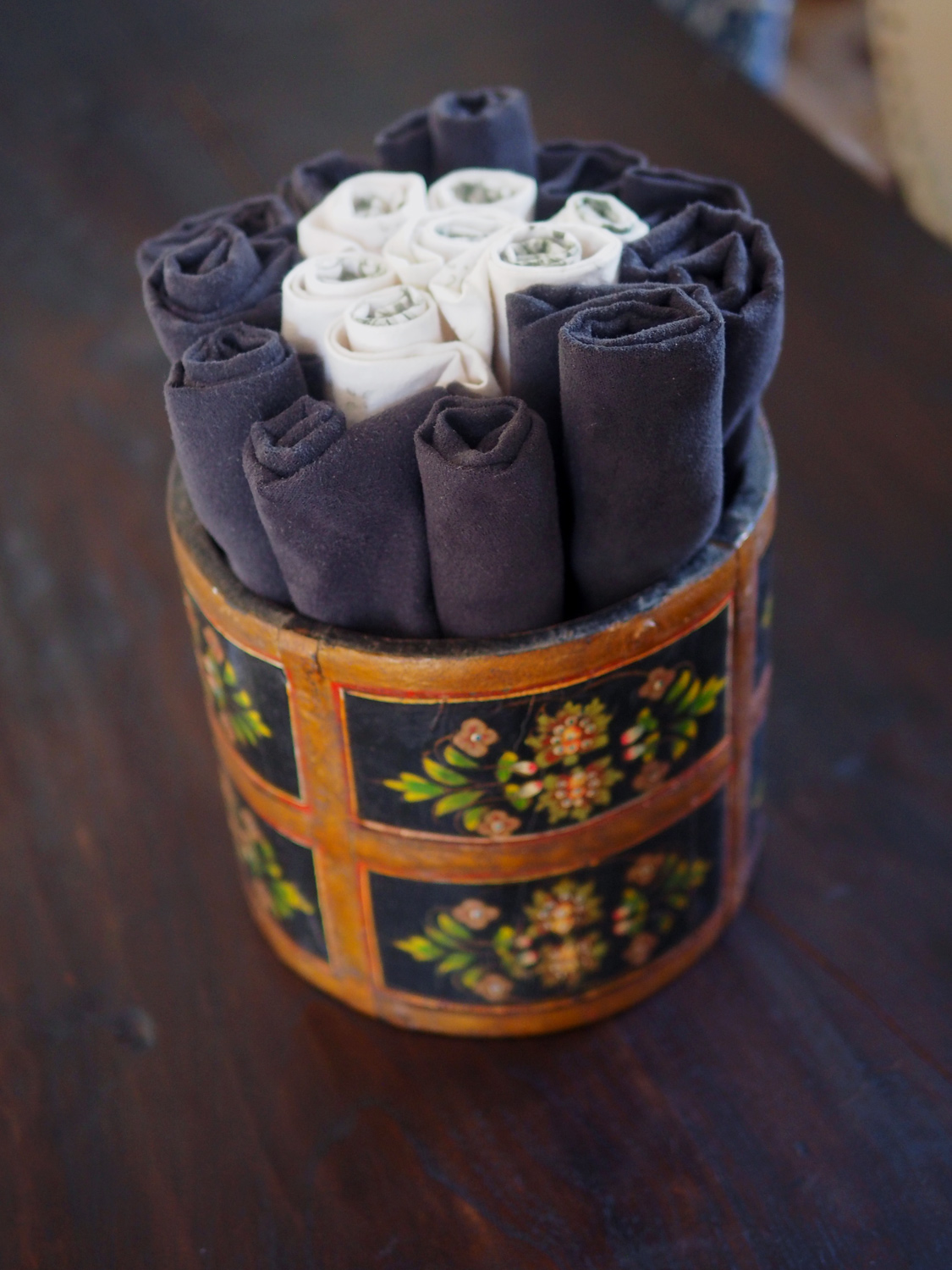 Roll up napkins   and place in decorative bucket.