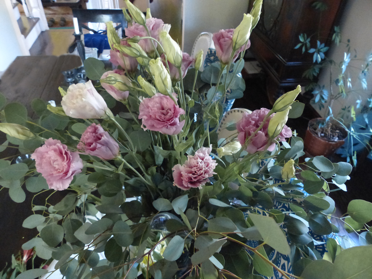 Grouping all the Lysianthus together creates a higher point of interest.