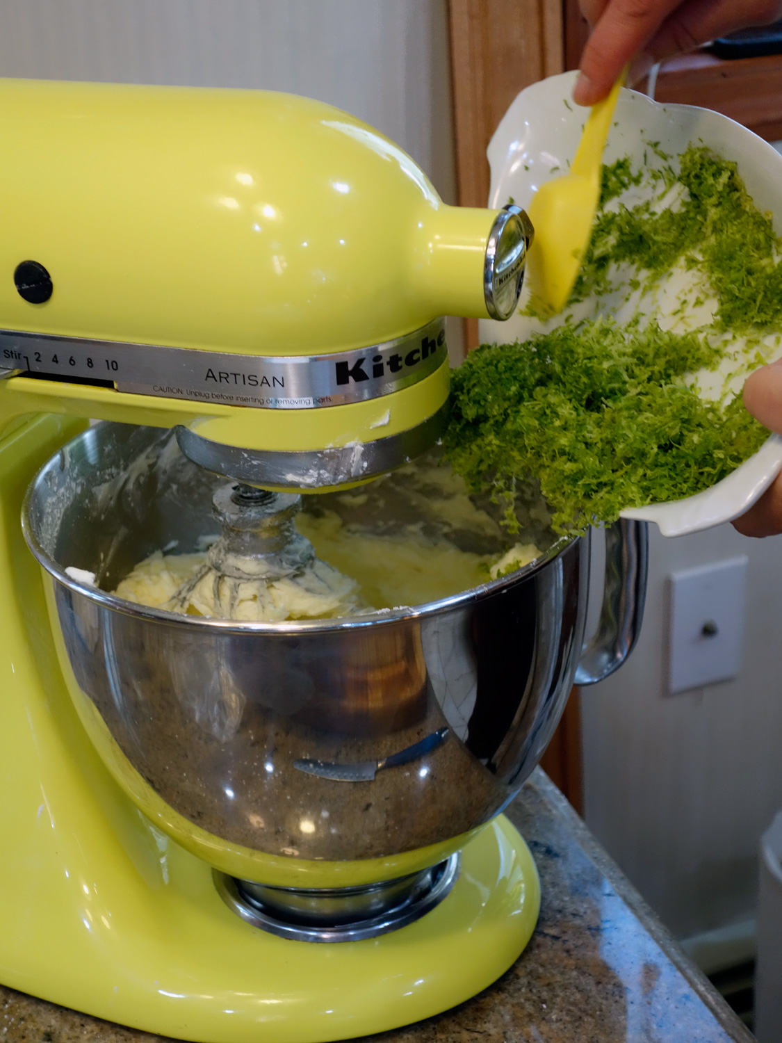 When you add the lime juice and zest the butter seems to break, but do not worry. It all comes together with the dry ingredients.  Photo credit:    asithappens.format.com