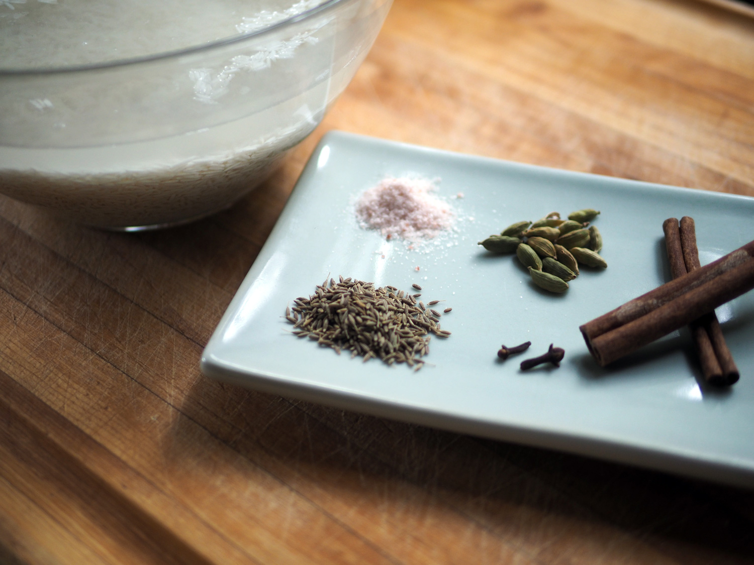 Mise en place, get everything ready and in place. Salt, cardamon seeds, cinnamon sticks, cloves, cumin seeds.