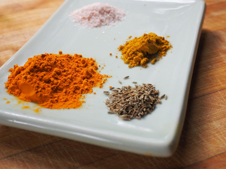 The spice of life. Turmeric, salt, curry powder, cumin seeds.