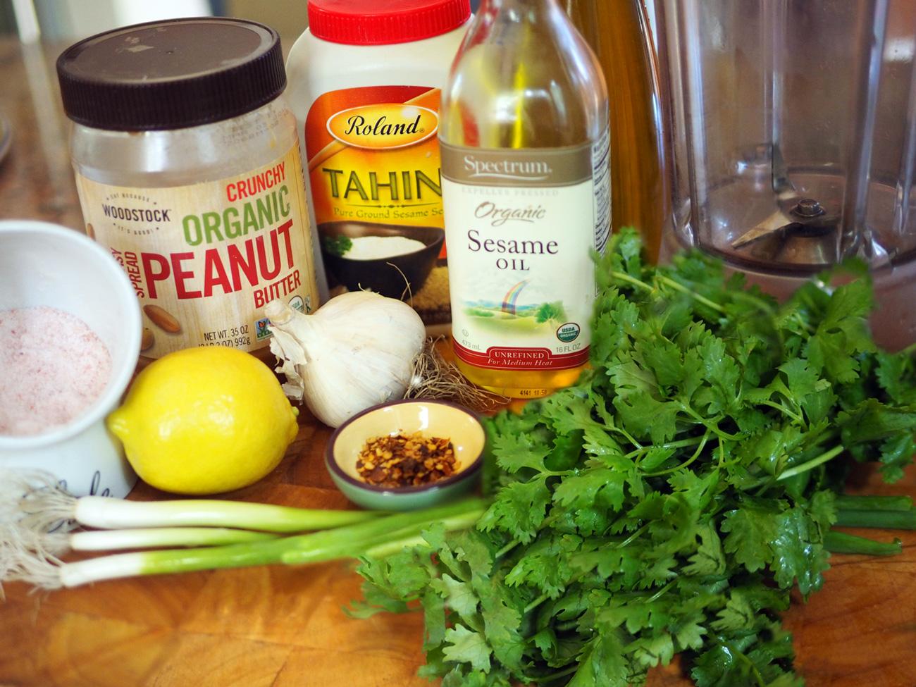 The stars, peanut butter, tahini, sesame oil, garlic, lemon, red pepper flakes, scallions and cilantro.