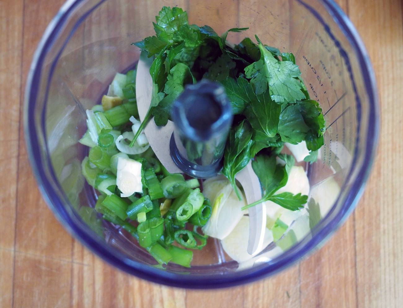 Toss the scallions, garlic and parsley in.