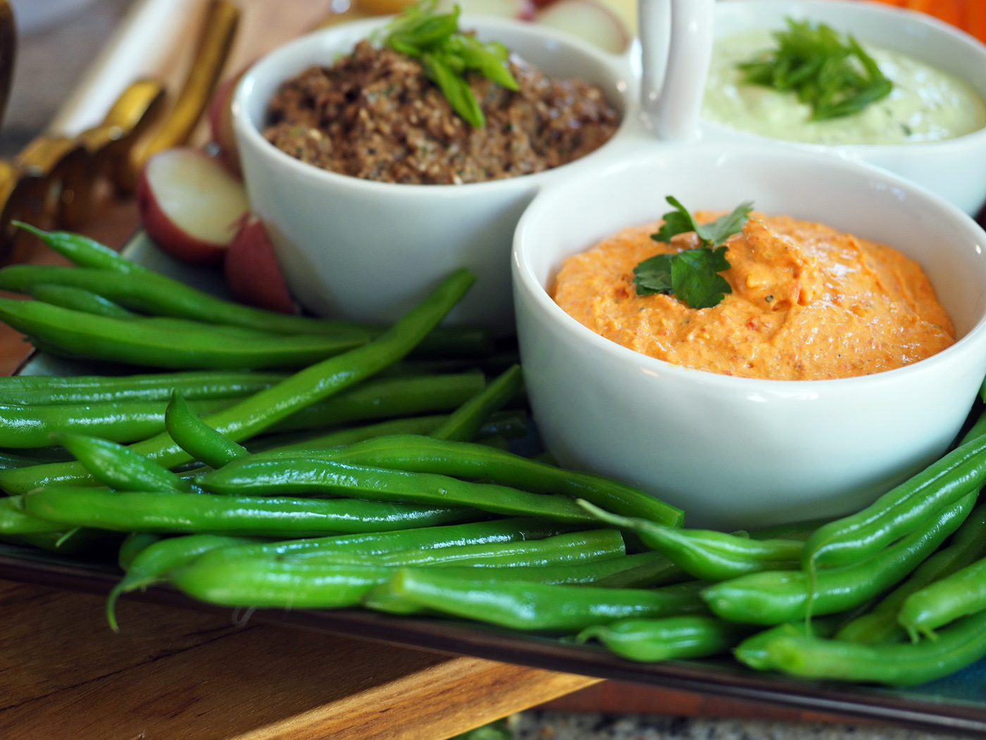 Bright, crunchy and super green string beans are a fresh and delightful addition to this platter.