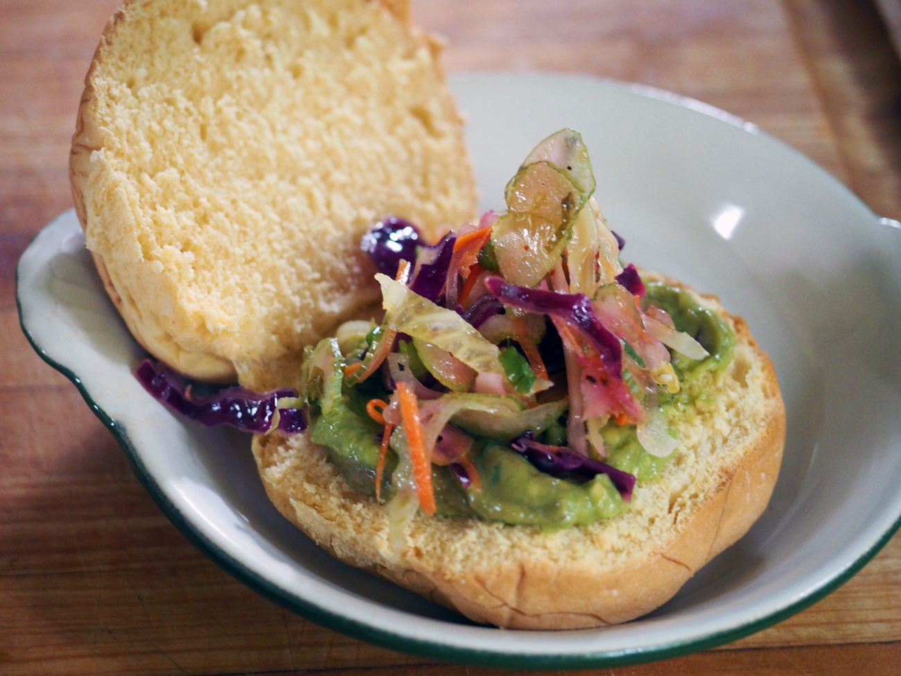 Start piling on the flavors. I think the slaw works nicely with the guacamole.