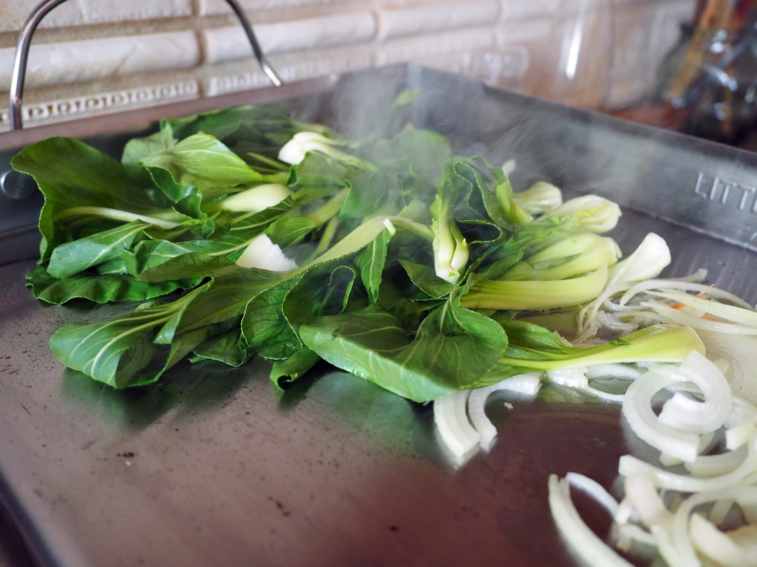 Bok Choy and onions getting stirred with love.