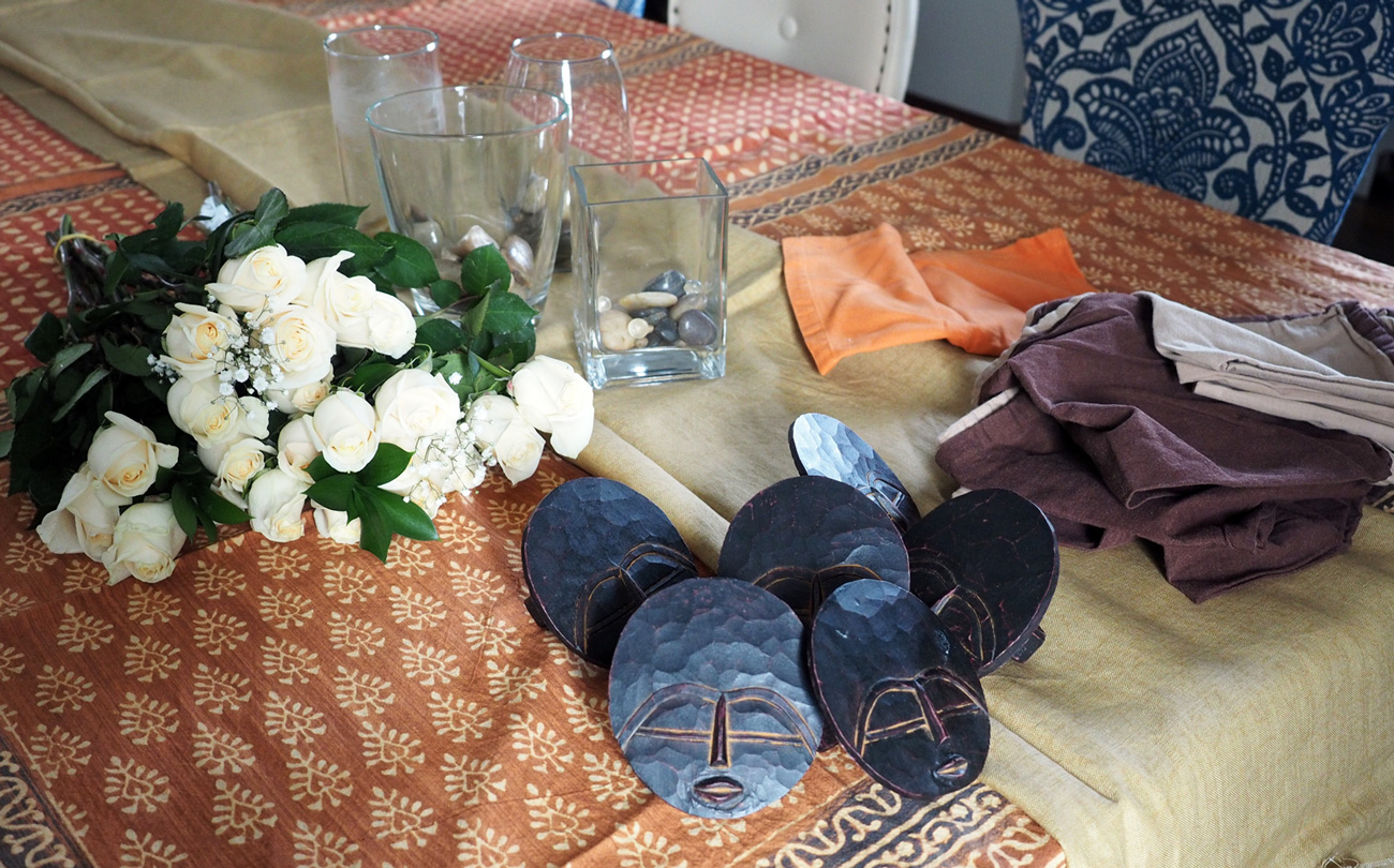Pulling out the elements to this African Flare table setting. I opted not to use the orange napkins. I wanted to tablecloth to stand out and go with a more neutral napkin.