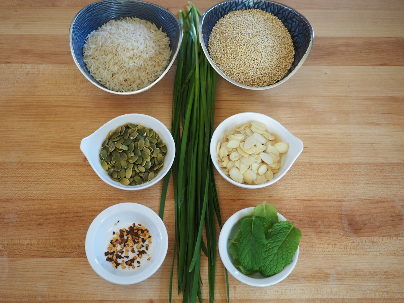 The main line up: Basmati Rice, Quinoa, Pepitas, Slivered Almonds, Fresh MInt, Red Pepper Flakes and Chinese Chives.