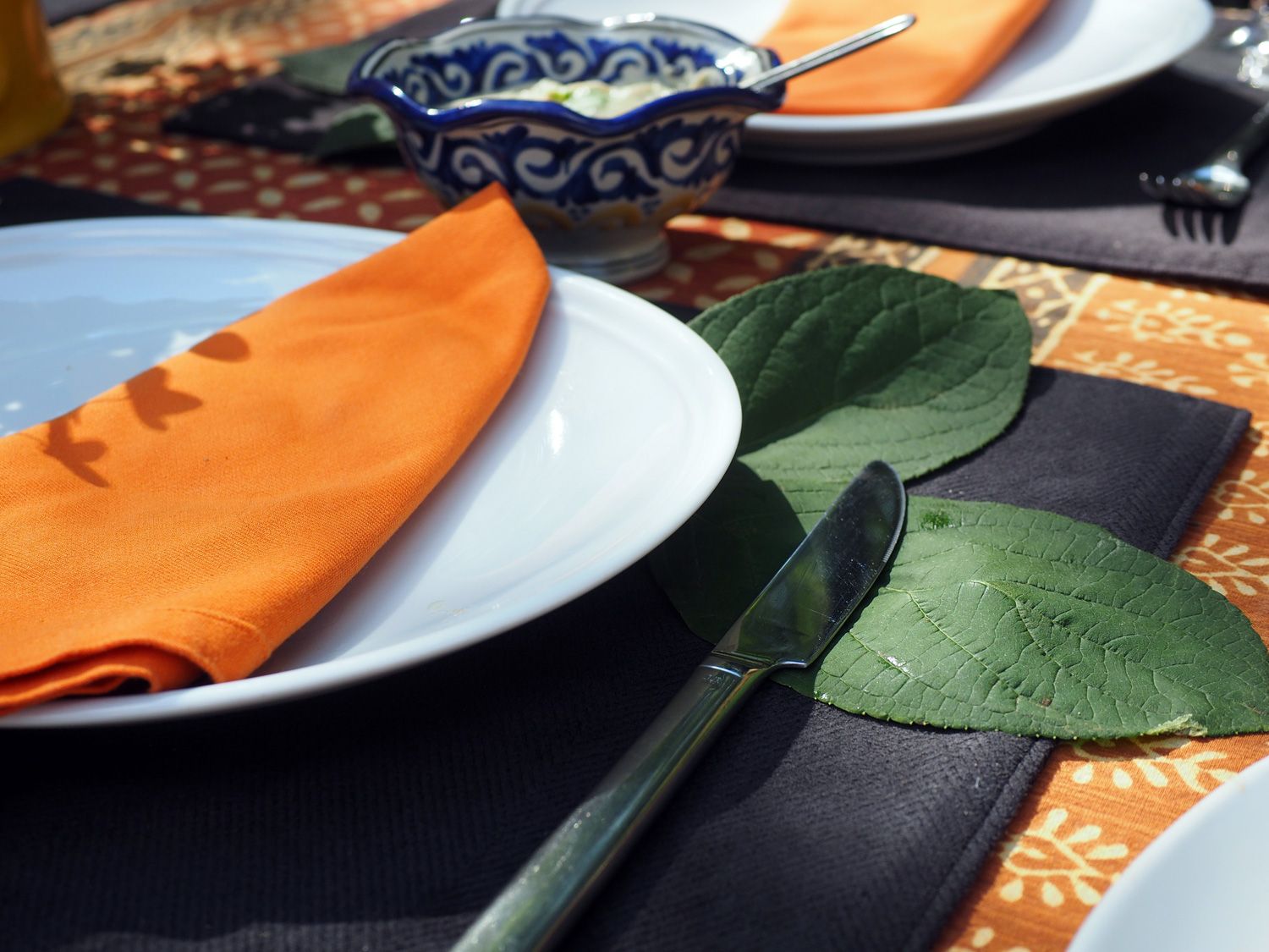 Color combinations can range from earthy to floral to plain white with pops of color. Just use your imagination and what feels good. Here I used some floral leaves as a landing spot for utensils and drinks.