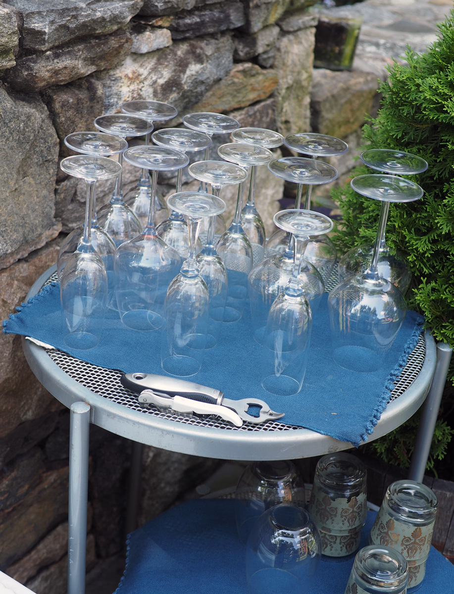 Have a spot where guests can grab their own glasses.