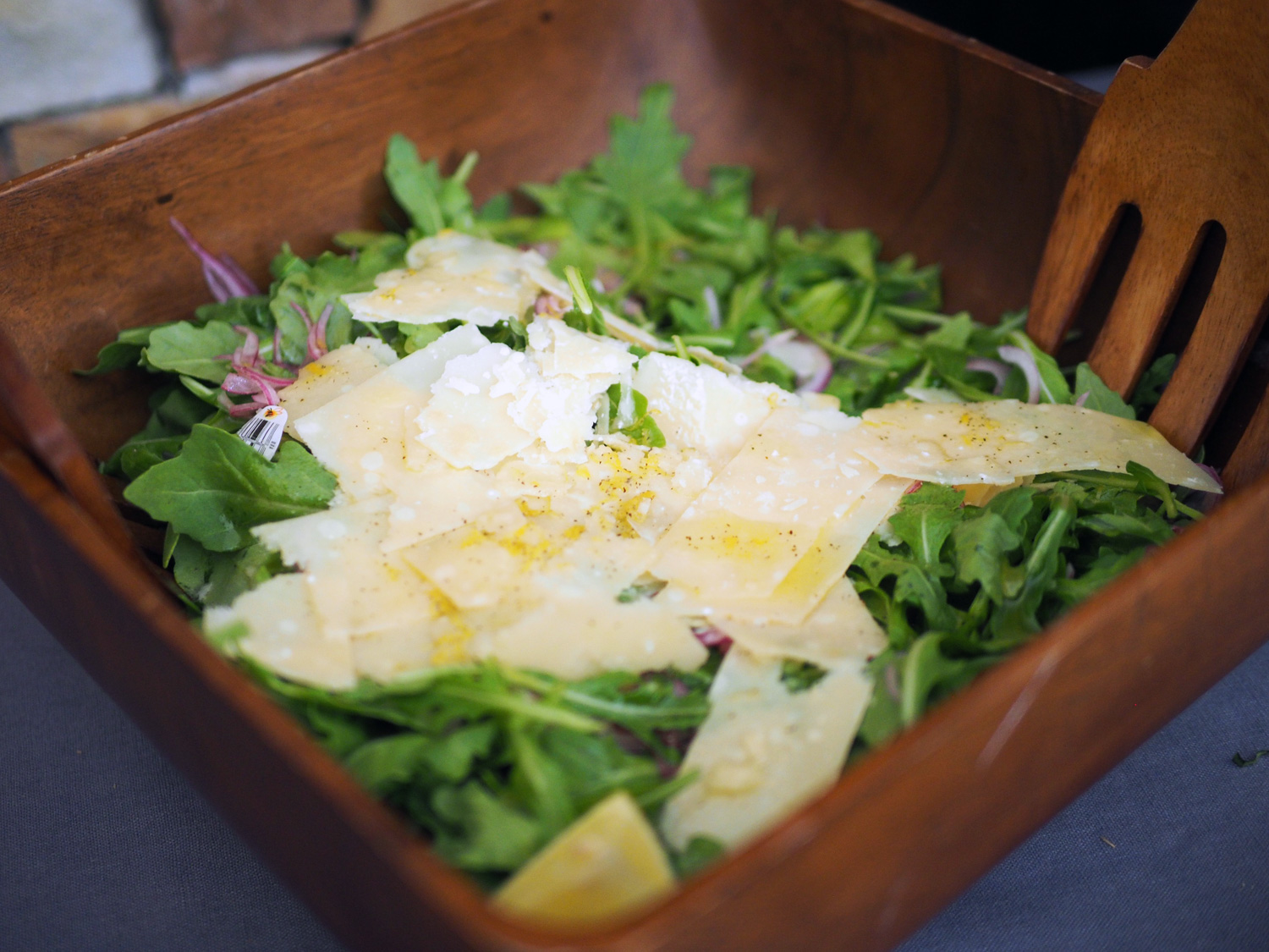 Peppery Arugula Salad with shaved Parmigiana Reggiano. It may be a simple salad but with just a few ingredients, it is a fresh, flavor punch.