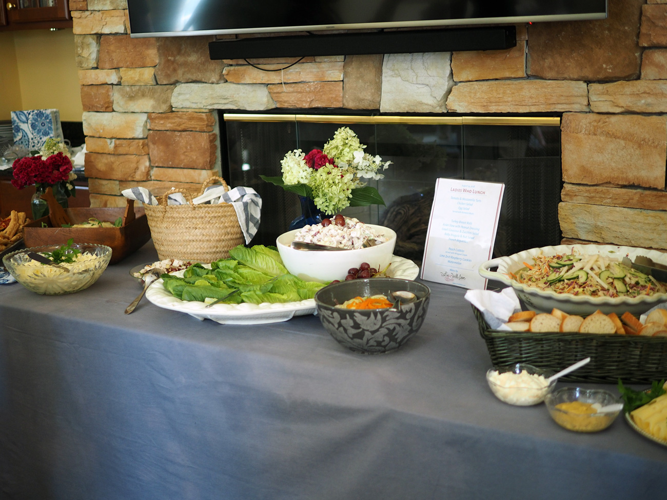 I was happy that they allowed me to move around furniture so we could set up the buffet table for maximum access. I placed a menu on the table with all the offerings. You can also place cards in front of each dish as a way to identify the food.