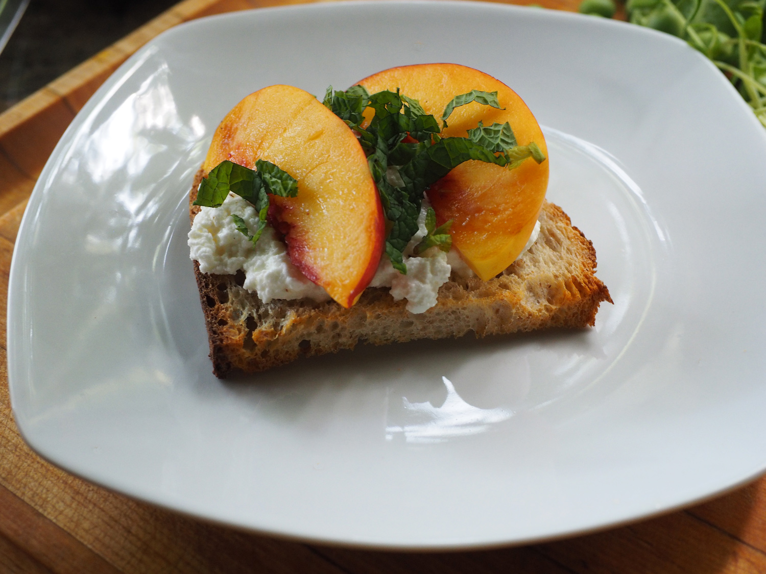 Ricotta & Nectarine crostini with mint syrup.